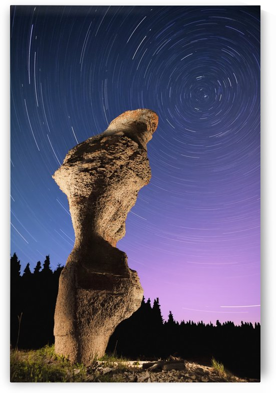 Light painting on monolith and star trails, Anse des Bonnes Femmes at Ile Niapiskau, Mingan Archipelago National Park Reserve of Canada, Cote-Nord, Duplessis region; Quebec, Canada by PacificStock