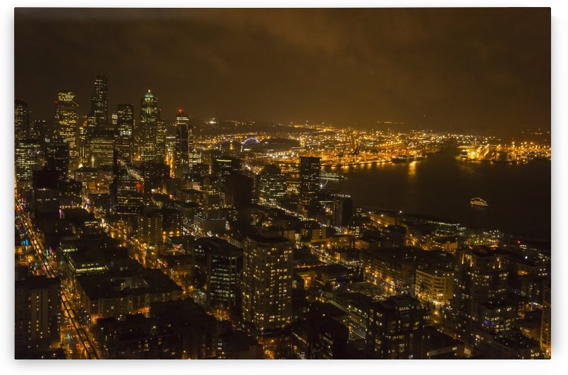 The lights of Seattle are viewed from the space needle at night; Seattle, Washington, United States of America by PacificStock