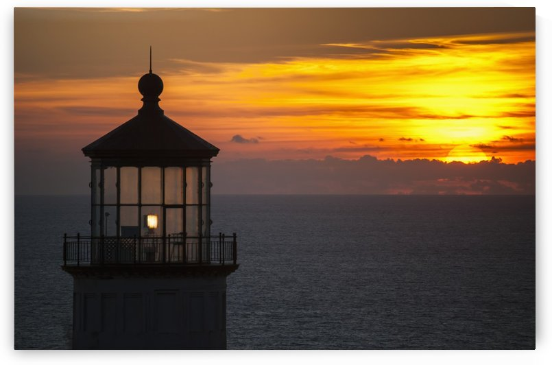 A sunset at North Head Lighthouse; Ilwaco, Washington, United States of America by PacificStock