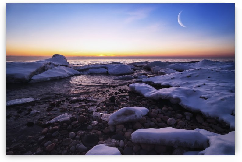 On the icy shores of Lake Michigan the moon (double exposed) and ice creates a beautiful morning; Wisconsin, United States of America by PacificStock