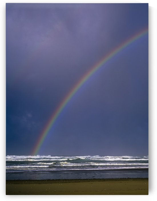 A rainbows arcs over the surf; Winchester Bay, Oregon, United States of America by PacificStock