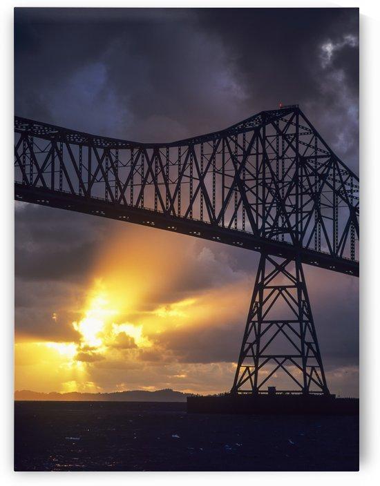 The sun sets below the Astoria-Megler Bridge; Astoria, Oregon, United States of America by PacificStock