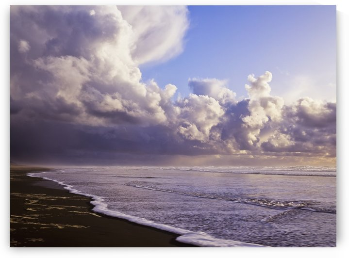 Clouds and tide moving onto the shore along the beach; Winchester Bay, Oregon, United States of America by PacificStock