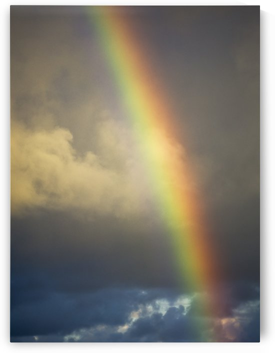 A rainbow brightens the sky; Charleston, Oregon, United States of America by PacificStock
