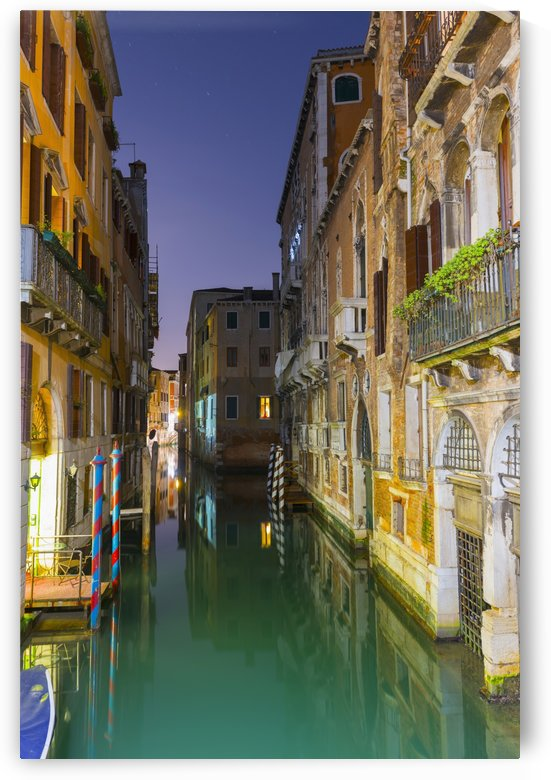 Turquoise water in a narrow canal between buildings at dusk; Venice, Veneto, Italy by PacificStock