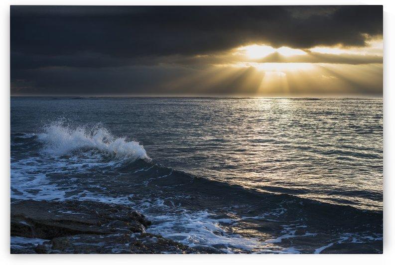 Surf breaks at sunrise; Wailua, Kauai, Hawaii, United States of America by PacificStock