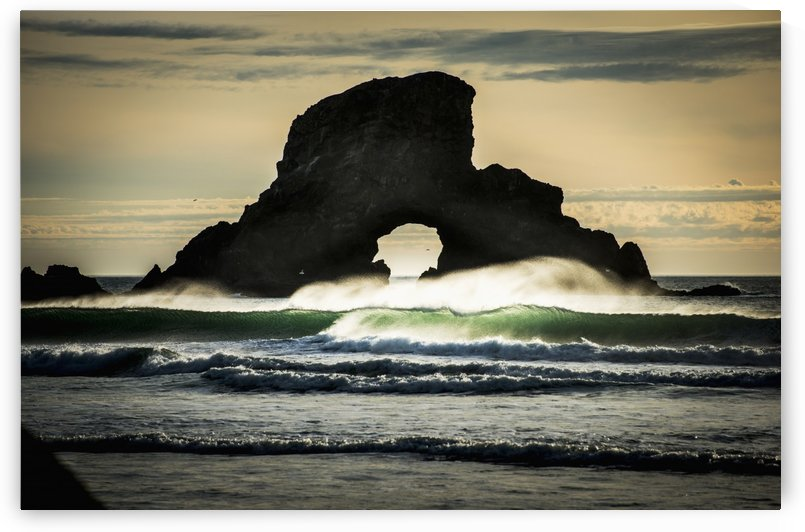 Surf breaks near a natural arch; Cannon Beach, Oregon, United States of America by PacificStock