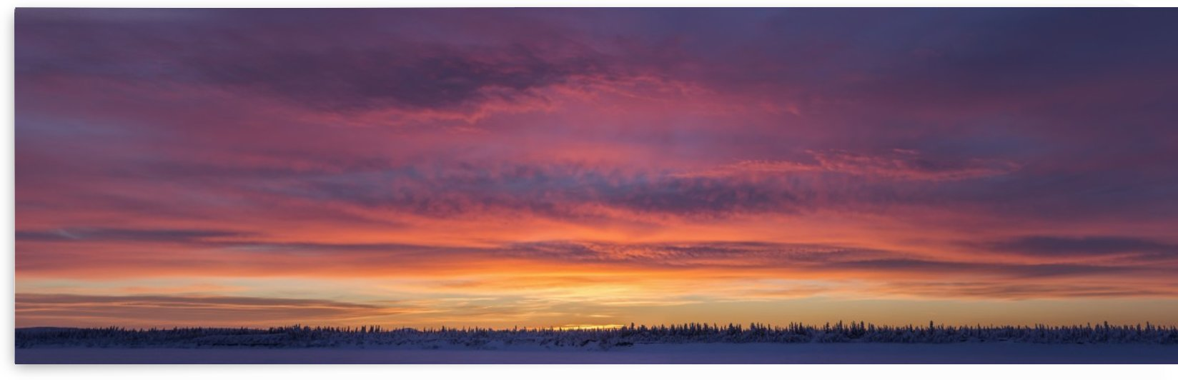 Sunrise clouds over the Porcupine River; Old Crow, Yukon, Canada by PacificStock