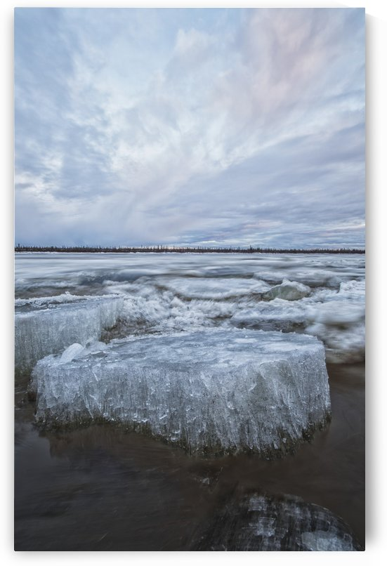 Long exposure of the ice flowing down the Porcupine River after it broke up; Old crow, Yukon, Canada by PacificStock