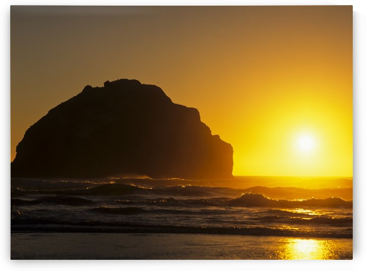 The sun sets near Face Rock; Bandon, Oregon, United States of America by PacificStock