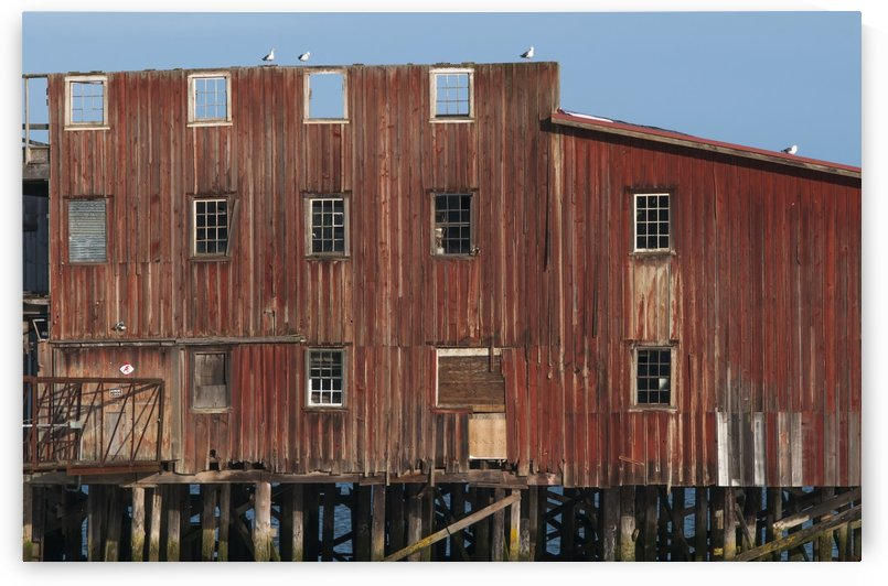The big red net shed is a prominent riverfront landmark; Astoria, Oregon, United States of America by PacificStock