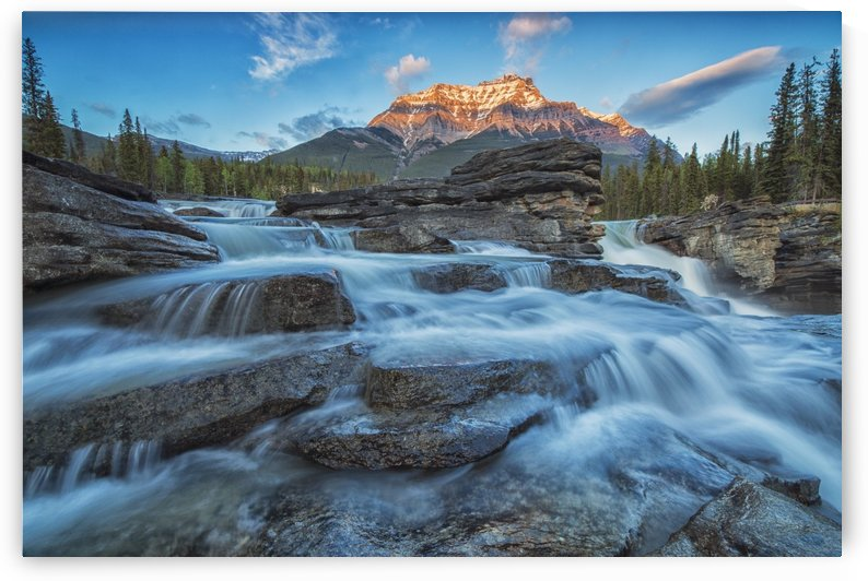 Sunset lights up Mount Fryatt as the Athabasca River flows over Athabasca Falls in Jasper National Park; Alberta, Canada by PacificStock