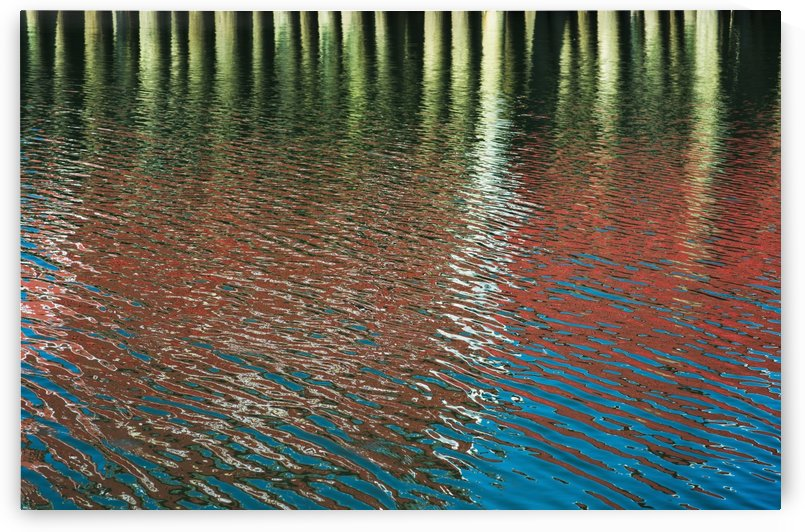 Ripples make patterns of reflections; Ilwaco, Washington, United States of America by PacificStock