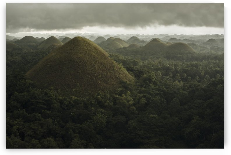 Chocolate hills landscape from Bohol Island, a big storm covers the sky making an interesting lighting effect; Carmen, Bohol Island, Philippines by PacificStock