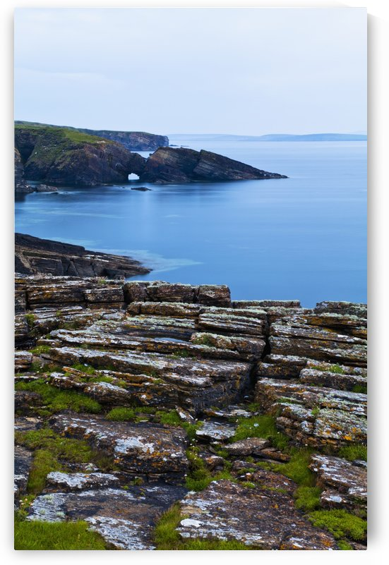 Tranquil water along the coastline of Orkney Islands; Orkney, Scotland by PacificStock