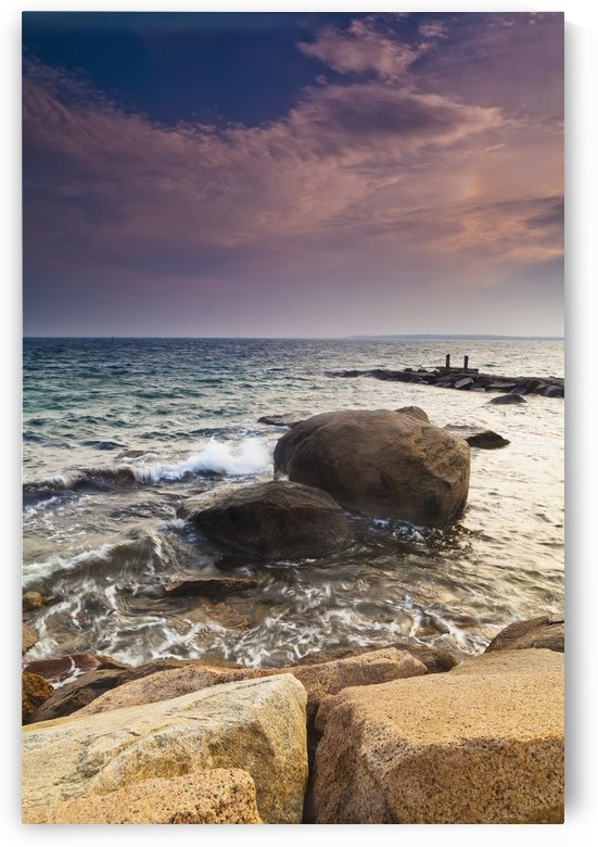 Glowing pink clouds at sunset and rocks along the coast; Falmouth, Massachusetts, United States of America by PacificStock