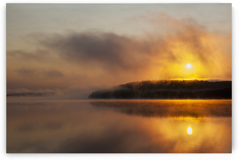 Sunrise over a calm, misty, wilderness lake; Ontario, Canada by PacificStock