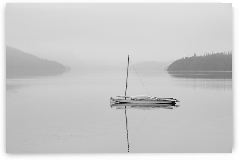 Solitary sailboat reflected in a misty calm lake; Ontario, Canada by PacificStock