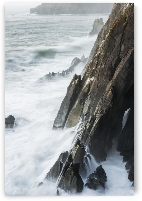 Surf breaks on the rocks; Manzanita, Oregon, United States of America by PacificStock
