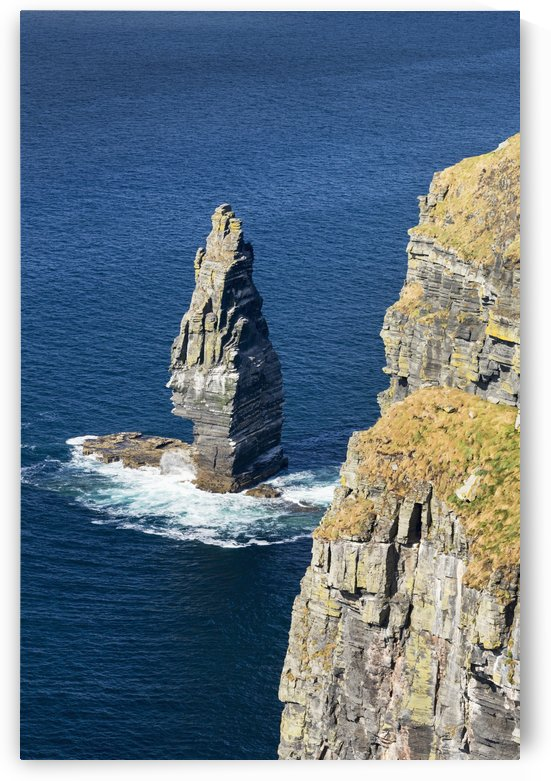 Large sea stack rock structure in the ocean with cliffs; Liscannor, County Clare, Ireland by PacificStock