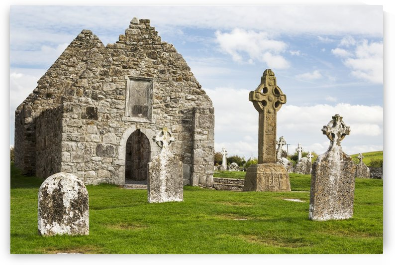Ancient stone roofless church with celtic crosses in a grassy field; County Offaly, Ireland by PacificStock