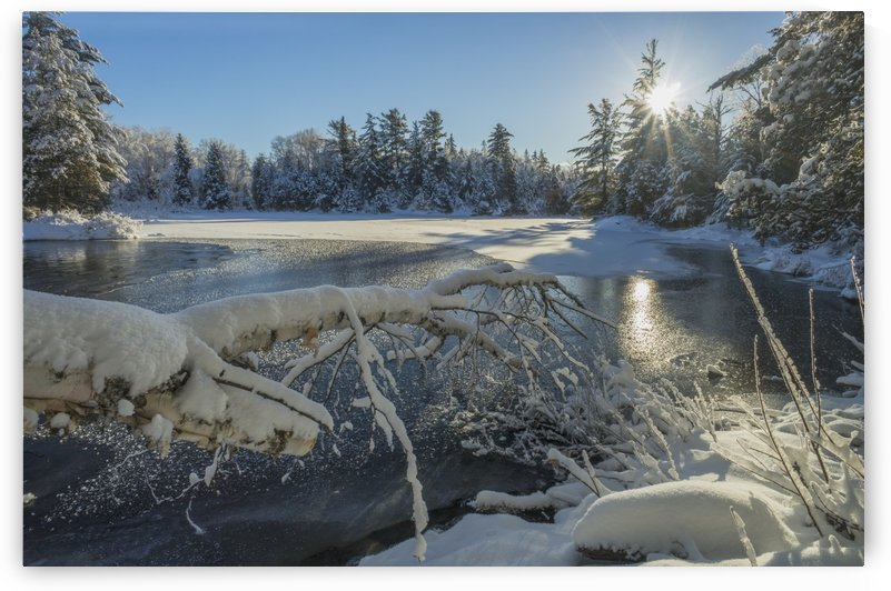 Winter landscape with ice on a lake; Ontario, Canada by PacificStock