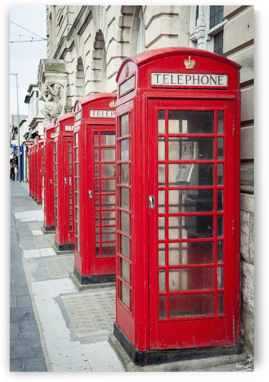 Telephone boxes in a row; Blackpool, Lancashire, England by PacificStock