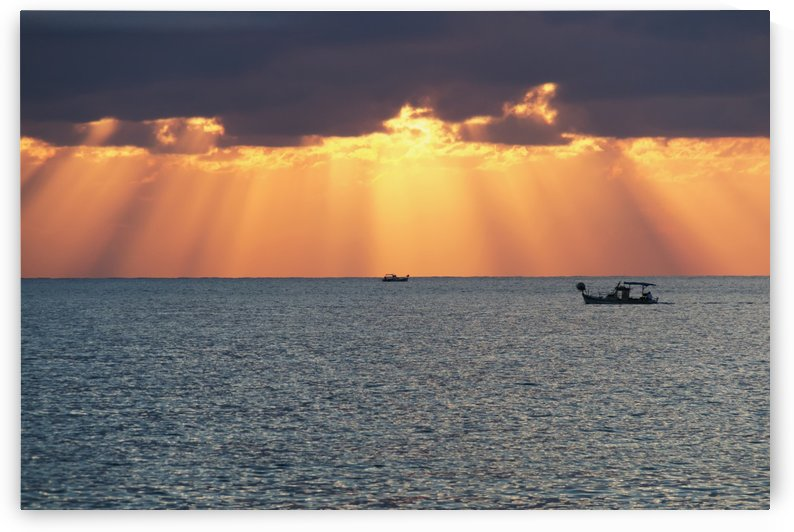 Dramatic sky with sun rays filtering down out of the storm clouds over the horizon; Paphos, Cyprus by PacificStock
