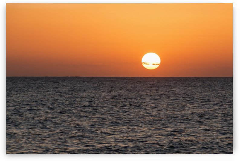 Glowing sun over the ocean and horizon at sunset; Paphos, Cyprus by PacificStock