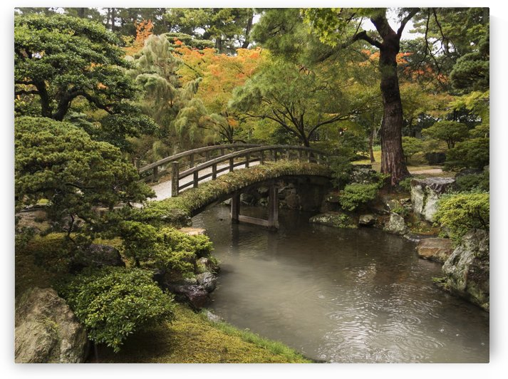 Japanese stone bridge across a stream in a park; Kyoto, Japan by PacificStock