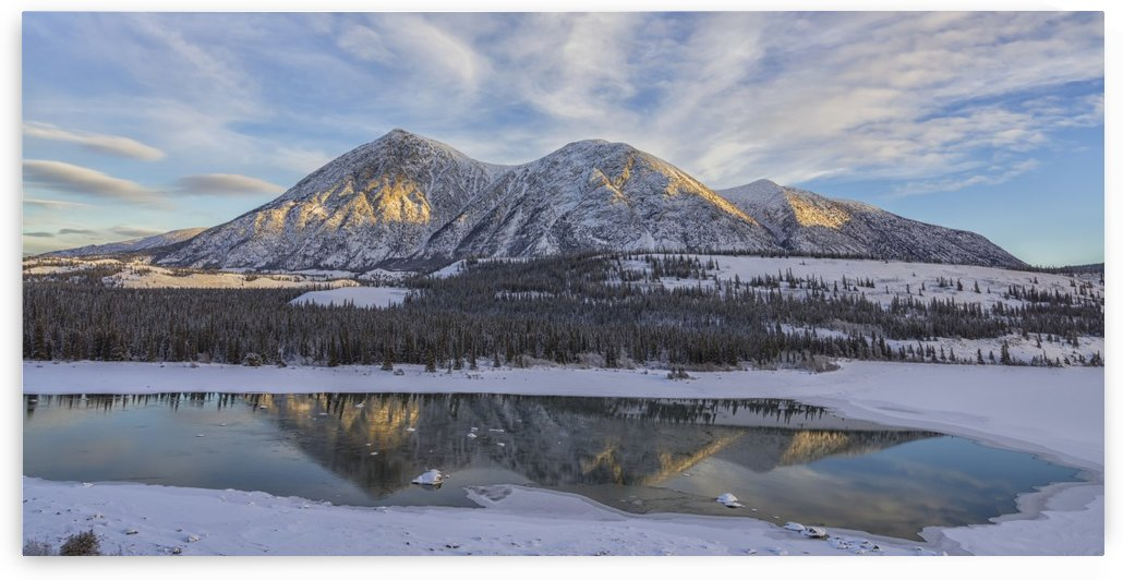 Late winter afternoon light warms up the mountains along the Takhini River, near Whitehorse; Yukon, Canada by PacificStock