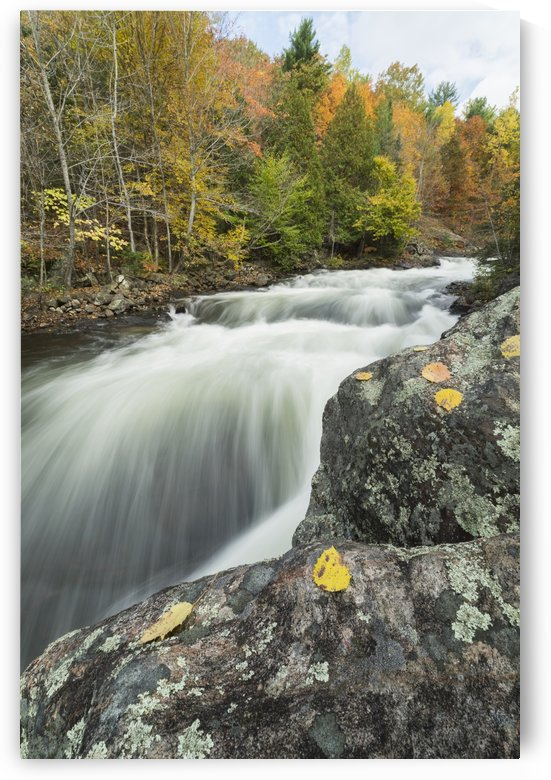 Long exposure of water flowing down Kawagama falls in the autumn, near Dorset; Ontario, Canada by PacificStock