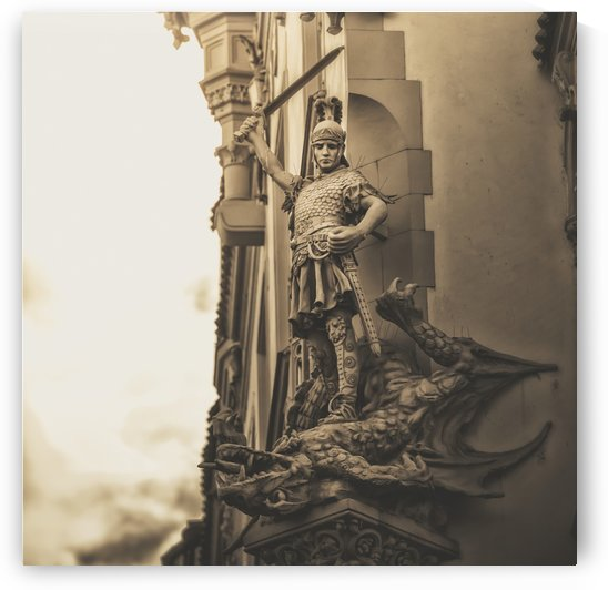Statue on the side of a building of a warrior slaying a dragon; Prague, Czech Republic by PacificStock
