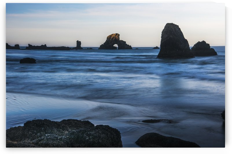 The sun comes up on sea stacks; Cannon Beach, Oregon, United States of America by PacificStock