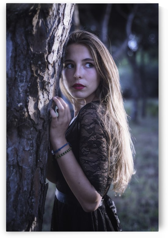 Young woman hiding in a forest; Tarifa, Cadiz, Andalusia, Spain by PacificStock