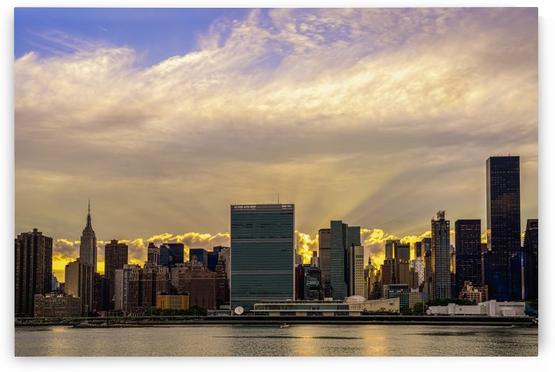 Sun setting behind United Nations; New York City, New York, United States of America by PacificStock