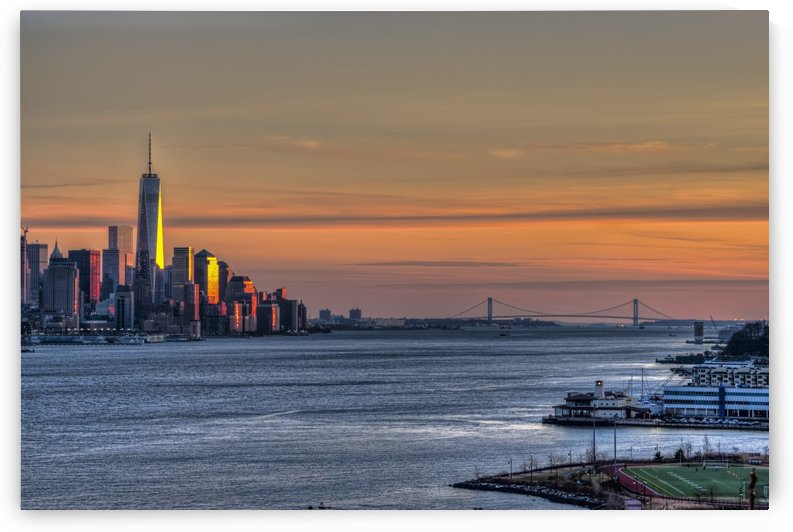 Sunset over Lower Manhattan and the Verrazano-Narrows Bridge; Weehawken, New Jersey, United States of America by PacificStock