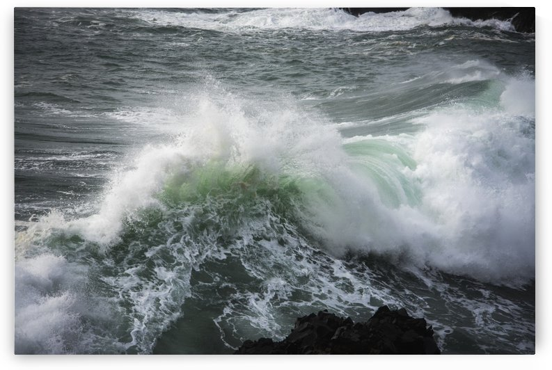 A large wave breaks; Manzanita, Oregon, United States of America by PacificStock