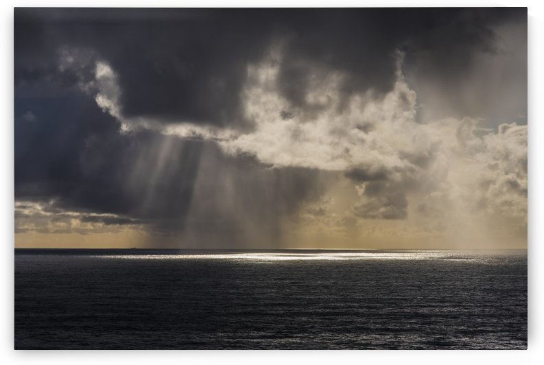 Rain falls in the distance off the coast; Oregon, United States of America by PacificStock