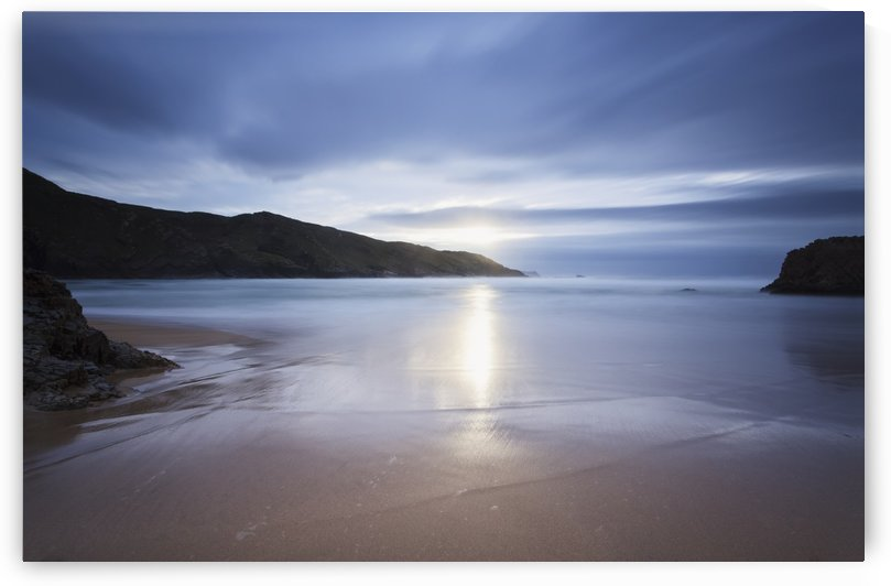 Sunlight reflecting on wet beach at Boyeeghter Bay; County Donegal, Ireland by PacificStock