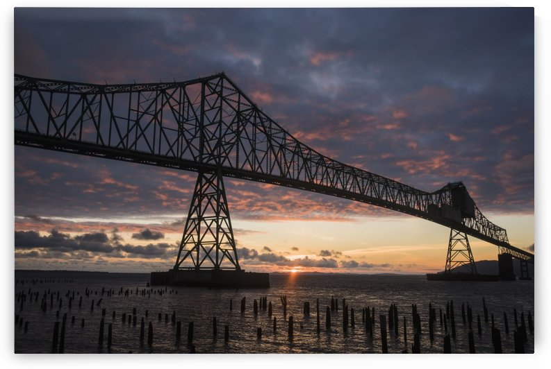 The sun sets over the mouth of the Columbia River; Astoria, Oregon, United States of America by PacificStock