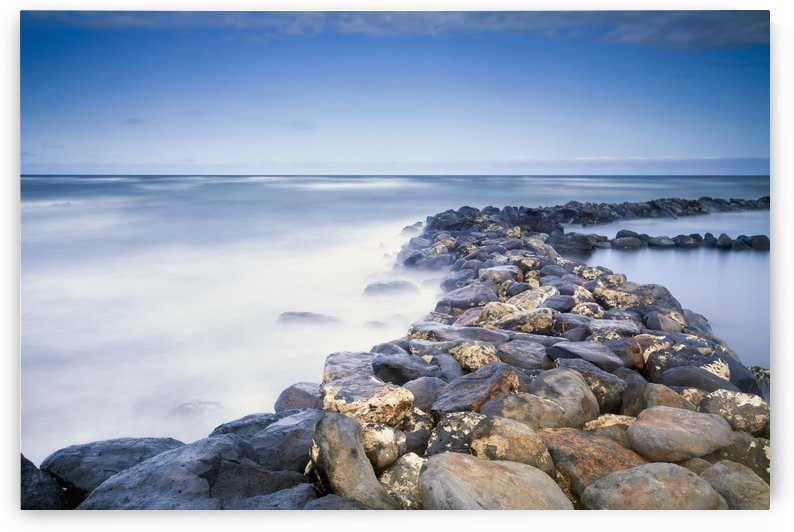 Rocks along the coast of Lydgate Beach Park; Lydgate, Kauai, Hawaii, United States of America by PacificStock