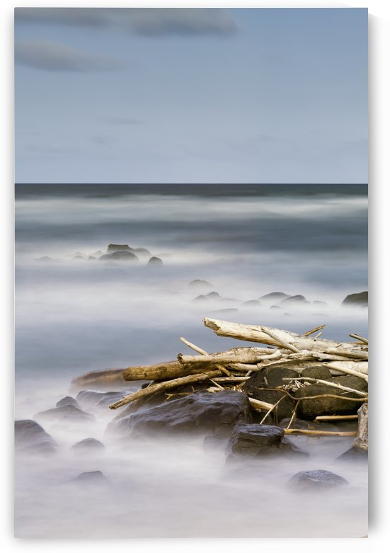 Driftwood and rocks along the coast of Lydgate Beach Park; Lydgate, Kauai, Hawaii, United States of America by PacificStock
