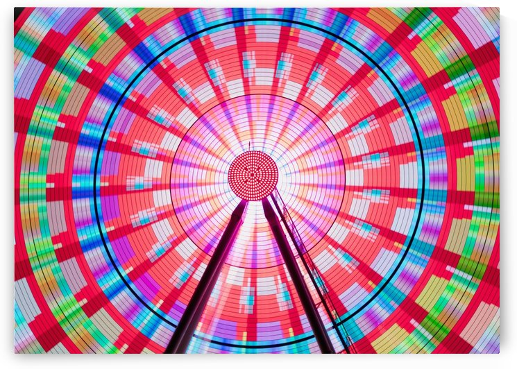 Long exposure photograph showcasing the many color combinations the Big Wheel produces at night; Seattle, Washington, United States of America by PacificStock