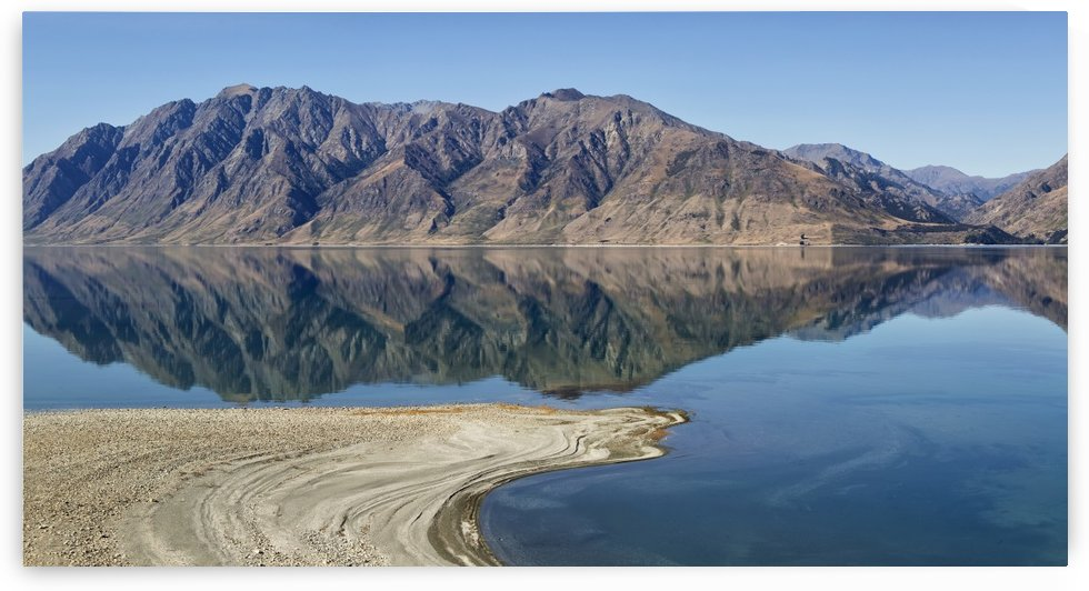 Lake Hawea with reflections of mountains; South Island, New Zealand by PacificStock