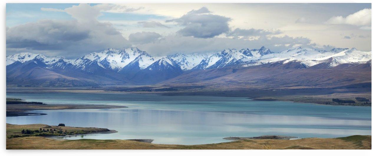 Lake Tekapo, with snow covered mountains; Tekapo, New Zealand by PacificStock