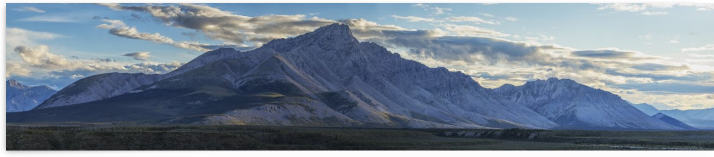 Panoramic image of Royal Mountain along the Wind River, Peel Watershed; Yukon, Canada by PacificStock