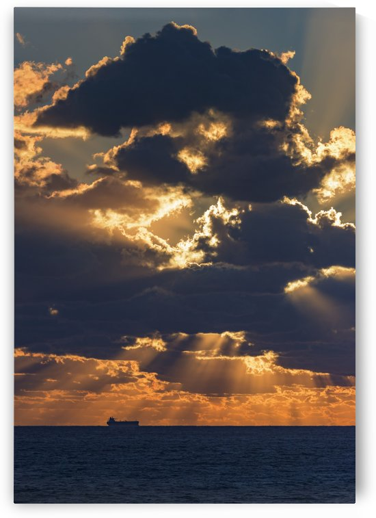 Dramatic sky with clouds glowing at sunset over the ocean and a ship in the distance; Tarifa, Cadiz, Andalusia, Spain by PacificStock