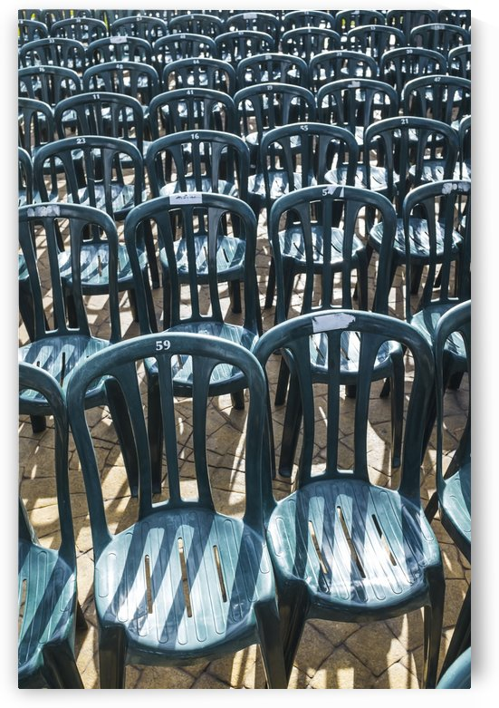 Plastic green chairs lined up in rows; Malaga Province, Andalusia, Spain by PacificStock