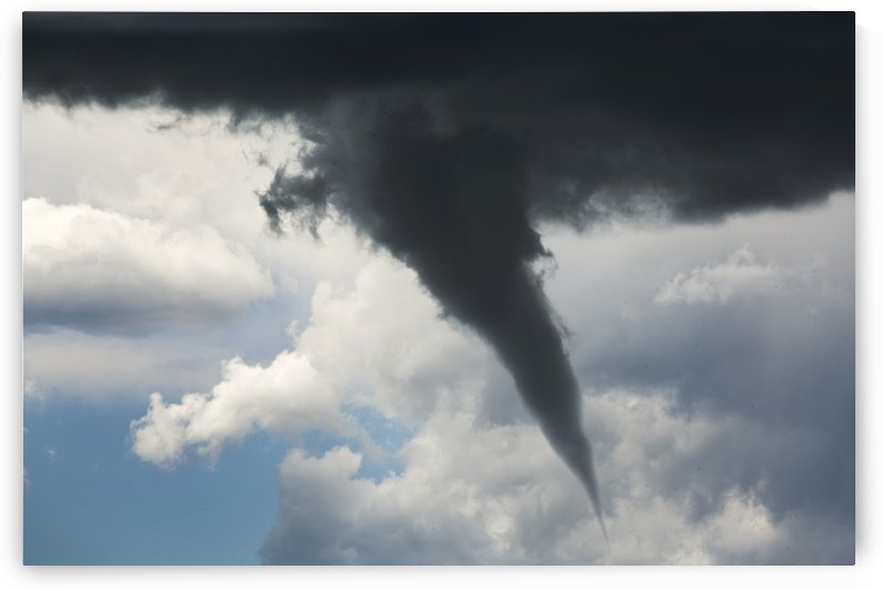 Dramatic funnel cloud created in dark storm clouds; Calgary, Alberta, Canada by PacificStock
